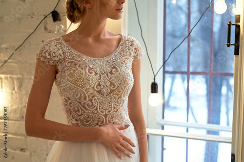 Stampa su Tela The bride in a white lace dress with embroidered bodice, indoors in loft style