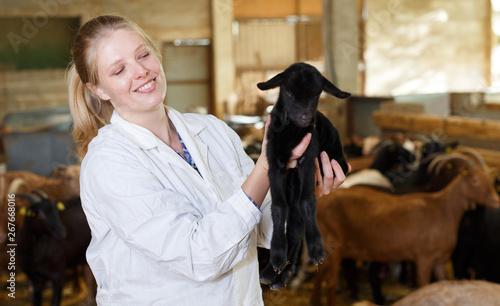 Fotografija Female farmer caring about goatlings
