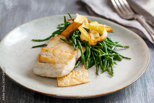 Canvas Print Sea bass fillet with parsnip crisp and samphire
