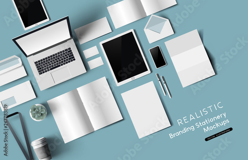 Wall mural Top down view of office desk realistic stationery and objects. Vector mockup illustration.
