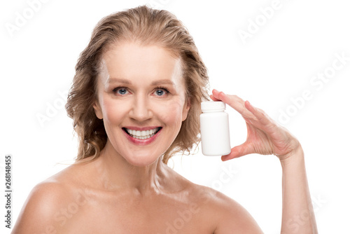 Mature woman nude portrait Smiling Nude Mature Woman With Bottle Of Medicine Isolated On White Stock Photo Adobe Stock