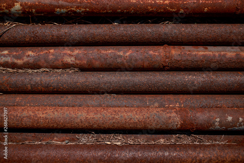Wallpaper Mural Rusty pipes. Corroded pipes lying parallel. Metal pipes.