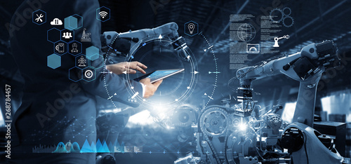 Stampa su Tela Manager Technical Industrial Engineer working and control robotics with monitoring system software and icon industry network connection on tablet
