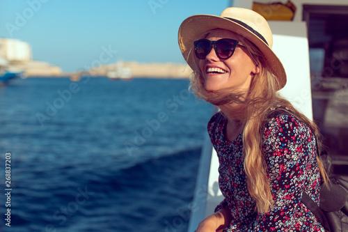 Happy mediterranean woman amazed by panorama on cruise ship Fototapeta