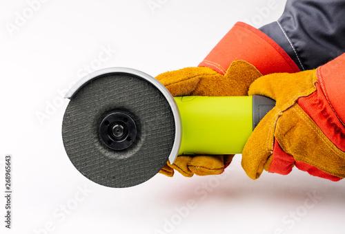 Fotografia, Obraz Angle grinder in hands  on white background