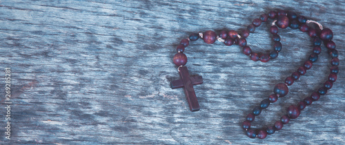 Fotografie, Obraz Close up rosary on wooden background as symbol of salvation and eternal life