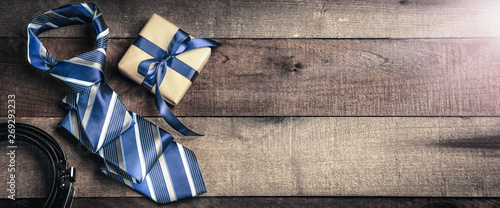 Photo Tie Belt And Gift Box  On Wooden Table With Sunlight - Fathers Day Concept