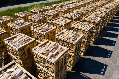 Obraz na plátně Rows of firewood stacked on pallets seen from above