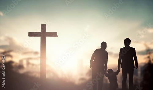 Fotografia, Obraz Family worship and praise concept: family praying before the cross