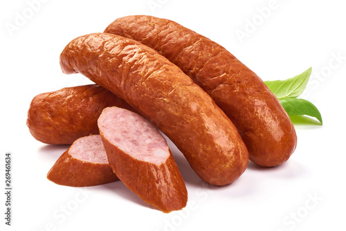 Photo Bavarian Smoked Sausages with basil leaves, dry meat, close-up, isolated on whit