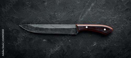 Obraz na plátně Kitchen old knife on a black stone table