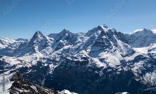 Fotografie, Obraz Eiger Mönch und Jungfrau, strahlender Sonnenschein und blauem Himmel