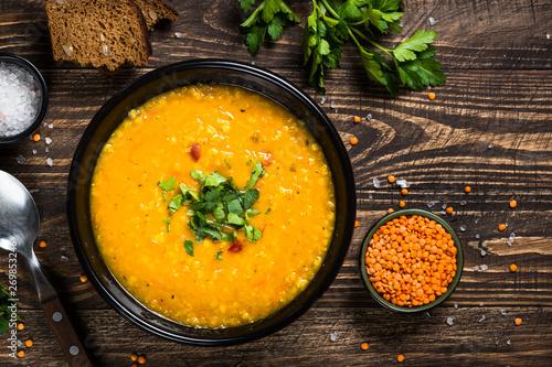 Canvas Print Red lentil soup top view.