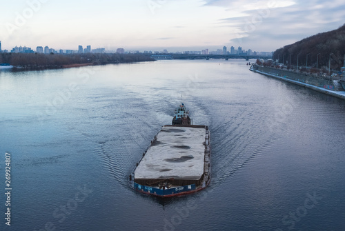 The barge floating in the Dnieper river Fototapeta