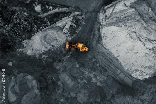 Valokuva Yellow excavator or bulldozer in coal open cast mining quarry, industrial extrac