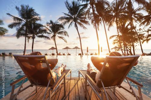 Obraz na plátně luxury travel, romantic beach getaway holidays for honeymoon couple, tropical va