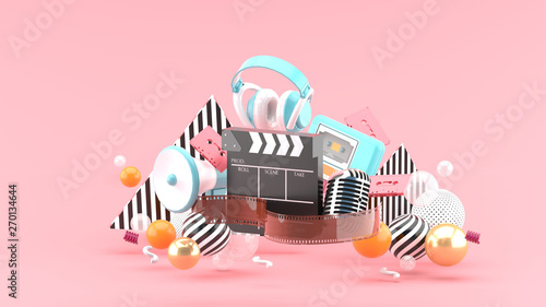 Cuadros en Lienzo Filmstrip and clapper movies and entertainment on pink blackground
