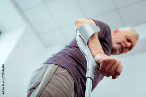 Obraz na płótnie Selective focus of a male hand holding crutches