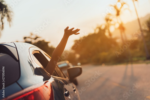 Canvas Print Hatchback Car travel driving road trip of woman summer vacation in blue car at s