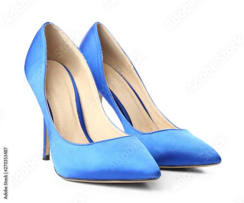 Fotografie, Obraz Pair of stylish high-heeled female shoes on white background
