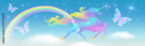 Fotografia Rainbow in the sky and galloping unicorn with luxurious winding mane against the