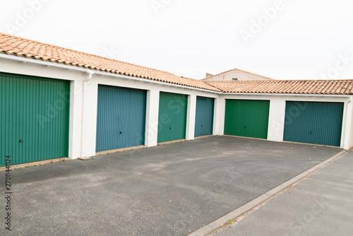 Fotografie, Obraz Row of parking garages car with green doors