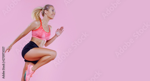 Young powerful beautiful runner fit girl studio portrait. Weight Loss. Healthy lifestyle. Sporty healthy fitness woman in action