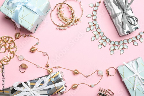 Vászonkép Beautiful jewelry and gift boxes on color background, flat lay
