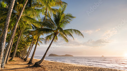 Fotografiet Panoramic view of an empty tropical beach at the sunrise with copy space