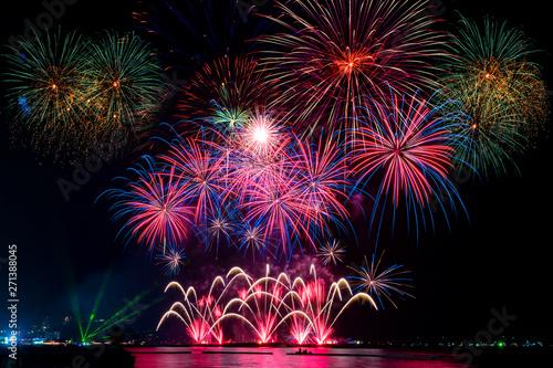 Amazing beautiful colorful fireworks display on celebration night, showing on th Fototapet