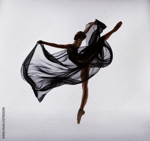Wallpaper Mural A ballerina dances with a black cloth