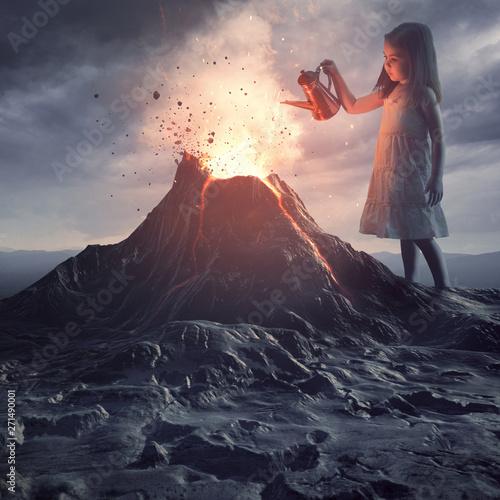 Fototapeta Little girl putting out volcano