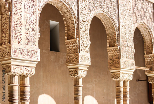 Tablou Canvas Arches with typical moorish decoration in Alhambra palace, Granada, Andalusia, S