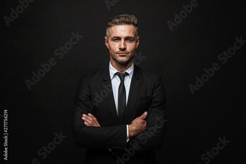 Valokuvatapetti Handsome confident businessman wearing suit