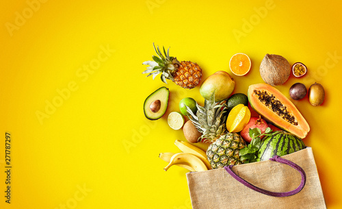 Variety of fresh tropical fruit on exotic yellow