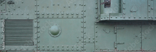Valokuva Abstract green industrial metal textured background with rivets and bolts