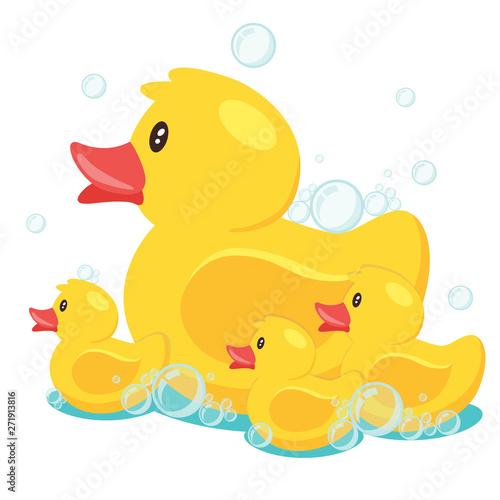 Valokuva Yellow cute cartoon rubber bath duck in blue water