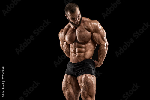 Canvas Print Bodybuilder man isolated on the black background