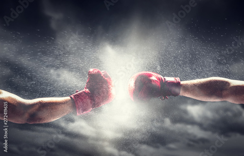 Leinwand Poster Two boxing gloves punch. Box and fight