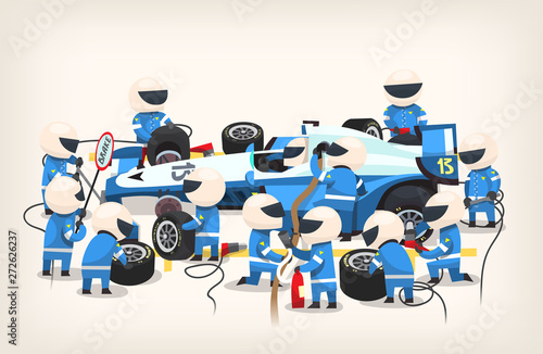 Fotografía Colorful image with pit stop workers and engineers wearing blue uniform maintaining technical service for a racing car during competition event