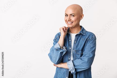 Fotografia, Obraz Happy bald woman posing isolated over white wall background.