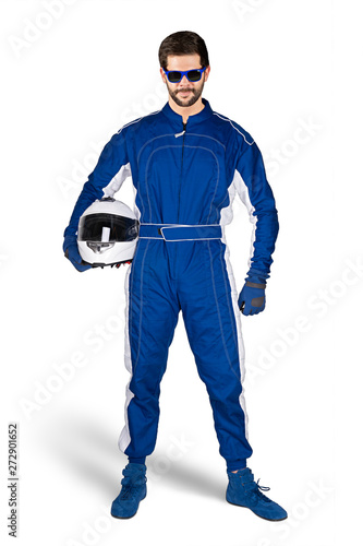 Fotografie, Obraz Race driver in blue white motorsport overall shoes gloves and safety gear crash helmet under his arm determined and ready to go isolated white background
