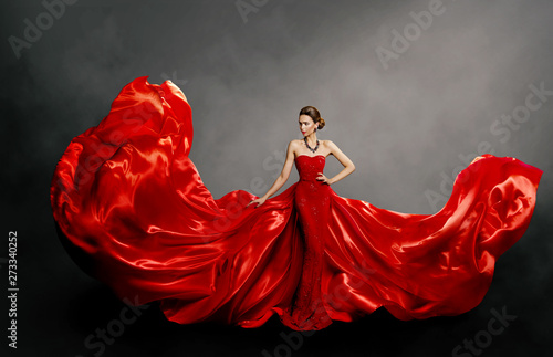Valokuva Woman Red Dress, Fashion Model in Long Silk Gown Waving Cloth on Wind, Flying Fl