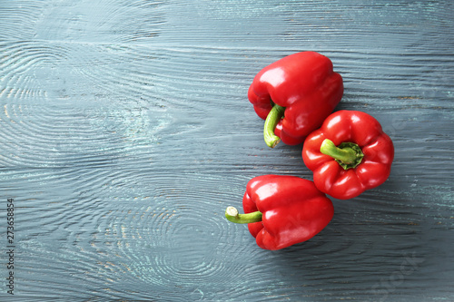 Fotografija Ripe red peppers on wooden background
