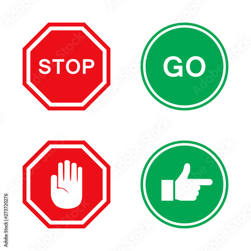 Obraz na plátně Stop and go signs in red and green with hand