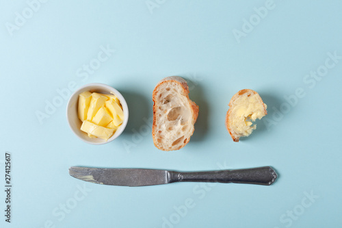 Two slice of bread or baguette with butter Fotobehang