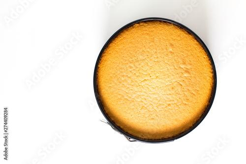 Valokuva Baking food concept fresh baked homemade sponge cake in cake pan on white backgr
