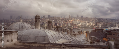 Fotografiet Istanbul cityscape in a cloudy day, view on the Bosphorus and Galata tower from the roofs