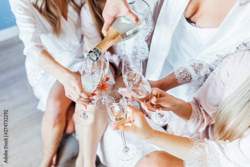 Wallpaper Mural Close up photo of womans drink champagne. Hen party.
