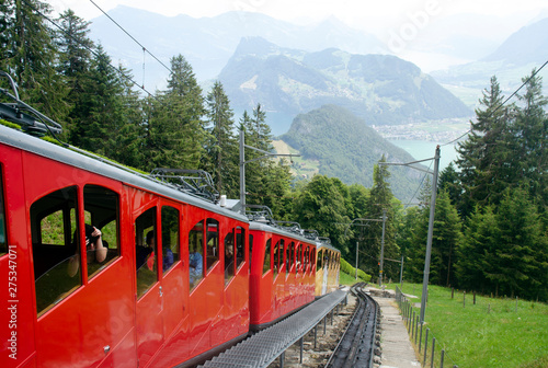 Wallpaper Mural Red panoramic train on the background of the Alps and mountain lakes